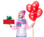 Fun happy adult woman with red gift box and balloons — Stock Photo