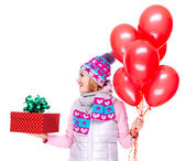 Adult woman with red gift box and balloons looking side — Stock Photo