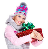 Woman holds the red christmas box gift — Stock Photo