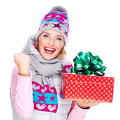 Portrait of fun woman with a gift in a winter outerwear — Stock Photo