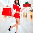 Snow maiden with shopping bags and box gift — Stock Photo #33331409