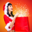 Surprised snow maiden with shopping bags with magic light  — Stock Photo