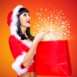 Surprised snow maiden with shopping bags with magic light — Stock Photo #33331475