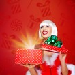 Snow maiden with a christmas gift with magic shining — Stock Photo #33331951