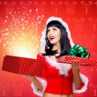 Snow maiden with a christmas gift with magic shining — Stock Photo