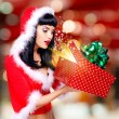 Surprised  snow maiden looks into the christmas box  with gift i — Stock Photo