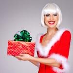 Beautiful snow maiden holds christmas new year gift box — Stock Photo #33332099