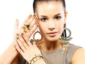 Woman with golden nails and beautiful gold jewelry — Stock Photo