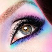 Woman eyes with beautiful fashion bright blue makeup — Stock Photo