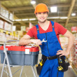 Manual worker with tools at warehouse — Stock Photo