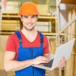 Handyman with laptop — Stock Photo