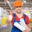 Professional worker with thumbs up — Stockfoto