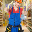 Stock Photo: Professional worker with thumbs up
