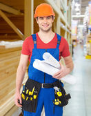 Handyman with tools and paper — Stockfoto