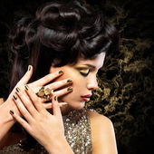 Woman with golden nails — Stock Photo