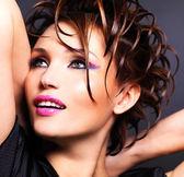 Beautiful saxy woman with bright pink makeup — Stock Photo