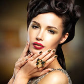 Woman with golded nails and red lips — Stock Photo