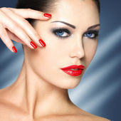 Beautiful woman with red nails and blue eyes — Stock Photo