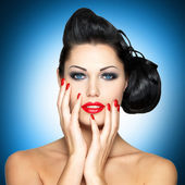 Woman with red nails — Stockfoto