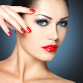 Woman with red nails — Stock Photo