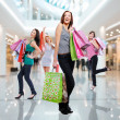 Foto Stock: Women with shopping bags