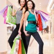 Girls with shopping bags — Stock Photo #34041993