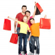 Family with shopping bags — Stock Photo