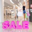 Woman with shopping bags poses at store — Stock Photo #34143173