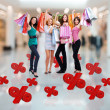 Happy women with shopping bags at store — Foto de stock #34143175
