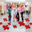 Happy women with shopping bags at store — Foto Stock #34143175