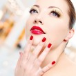Woman with red manicure — Stock Photo #34143197