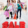 Happy women with shopping bags at store  — Foto Stock