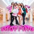 Happy women with shopping bags at store — ストック写真