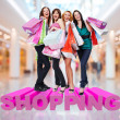 Happy women with shopping bags at store — Photo