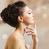 Beautiful elegant woman with black nails — Stock Photo