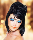 Face of a beautiful woman with blue makeup — Stock Photo