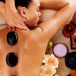 Woman having hot stone massage — Stock Photo #35471153