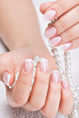 Woman's nails with french manicure — Stock Photo