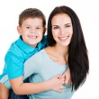 Happy smiling young mother with son — Stock Photo