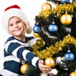 Child  near the Christmas tree — Stock Photo