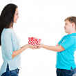 Happy son giving a gift to his mother. — Stock Photo #37050329