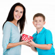 Happy son giving a gift to his mother. — Stock Photo #37050377