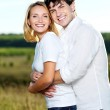 Happy beautiful couple on nature — Stock Photo #4090253