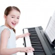 Smiling girl plays on the electric piano. — Stock Photo #41926831