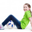Smiling little girl sitting with ball. — Stock Photo #41926967