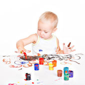 Little baby paint by his hands. — Stock Photo