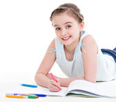 Little smiling girl lies with the book. — Stock Photo