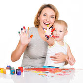 Happy young mother and child with painted hands. — Stockfoto