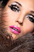 Beautiful woman with bright professional make-up — Stock Photo