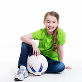 Smiling little girl sitting with ball. — Stok fotoğraf